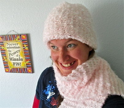 A fuzzy hat and scarf set I knitted for my mum. :) .  Make a beanie by knitting with knitting needles, furry yarn, and circular knitting loom. Inspired by clothes & accessories. Creation posted by Crystal H. Difficulty: Easy. Cost: Cheap.