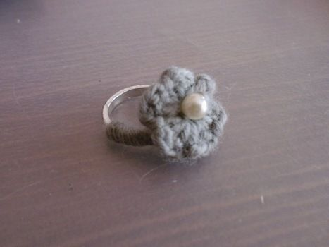 Ring with a cute crocheted flower .  Stitch a knit or crochet ring in under 15 minutes by sewing and crocheting with crochet hook, bead, and rings. Creation posted by wellitsMijke. Difficulty: Simple. Cost: Absolutley free.