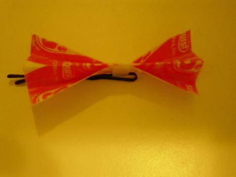 .  Make a recycled hair clip in under 5 minutes Version posted by sweetsundae0. Difficulty: Easy. Cost: Absolutley free.