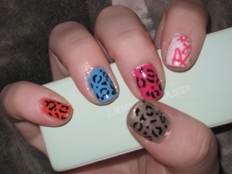 Wiggle, wiggle, wiggle, wiggle, wiggle, YEAH .  Paint an animal nail in under 30 minutes by nail painting with nail polish. Inspired by leopard print. Creation posted by TamrynRoxanne. Difficulty: Easy. Cost: No cost.