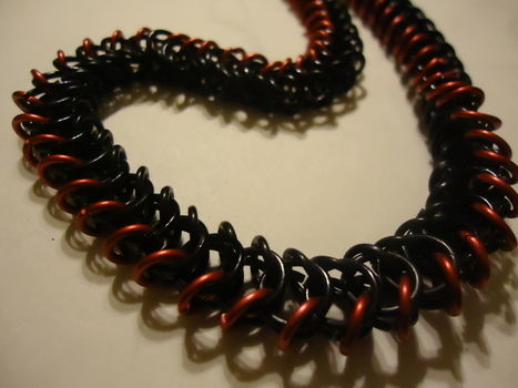 A little something I made for a friend .  Make a chainmaille necklace in under 180 minutes by chainmailing with jump rings. Creation posted by aranumenwen. Difficulty: 3/5. Cost: Cheap.