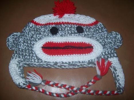 OOH OOH! .  Make an animal hat by cross stitching, embroidering, and weaving with scissors, yarn, and needle. Inspired by costumes & cosplay, monkeys, and clothes & accessories. Creation posted by Savoia S. Difficulty: 3/5. Cost: Cheap.