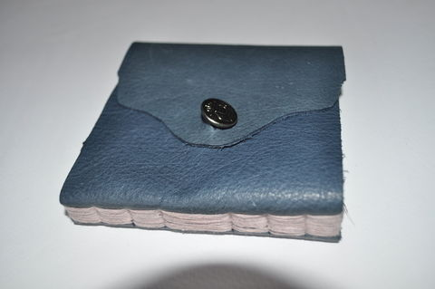 Soft Leather Bound Book .  Make a leather journal by constructing and bookbinding with buttons, paper, and needle. Creation posted by Jessica C. Difficulty: 4/5. Cost: Cheap.