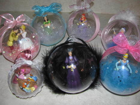 Disney Ornaments are so expensive! Make some yourself! .  Free tutorial with pictures on how to make a bauble in under 60 minutes by decorating with ribbon, hot glue gun, and decoupage glue. Inspired by christmas. How To posted by Shelley8123. Difficulty: Simple. Cost: Cheap. Steps: 1