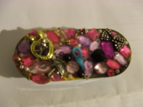 A lame throwaway turned into glitz and glam! .  Embellish a bejewelled box in under 30 minutes by mosaic and not sewing with super glue, rhinestones, and tin. Inspired by crafts and juicy couture. Creation posted by Supernova's Child. Difficulty: Simple. Cost: Absolutley free.