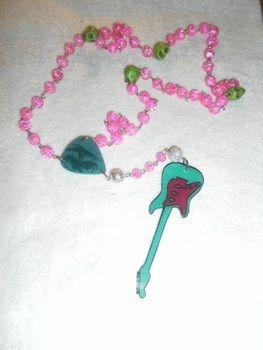 Cute girly rock rosary .  Make a rosary necklace in under 45 minutes by jewelrymaking with beads, beads, and paper. Inspired by kawaii and clothes & accessories. Creation posted by Angie. Difficulty: Simple. Cost: Cheap.