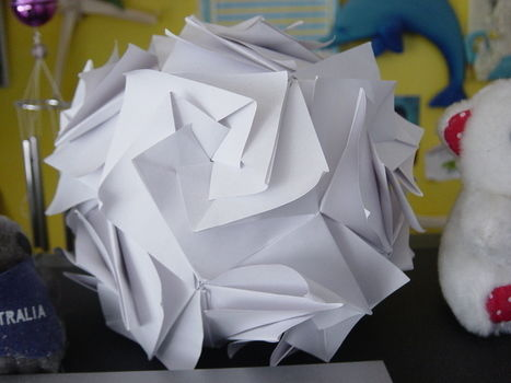 Origami Flower Ball .  Free tutorial with pictures on how to make an origami flower in 4 steps by paper folding with paper. How To posted by sweetsundae0. Difficulty: 4/5. Cost: Cheap.