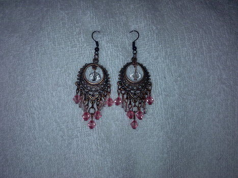 Pink and white crystal beaded earrings .  Make a pair of chandelier earrings in under 40 minutes by jewelrymaking with crystal beads and earring findings. Inspired by clothes & accessories. Creation posted by Nilüfer . Difficulty: Simple. Cost: Cheap.
