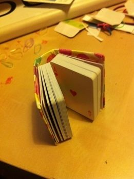 A book made from mini playing cards .  Free tutorial with pictures on how to make a playing card notebook in under 90 minutes by constructing, papercrafting, bookbinding, and paper folding with paper, card, and pva glue. Inspired by books. How To posted by Amie D. Difficulty: Simple. Cost: Absolutley free. Steps: 11