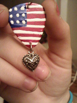 American Flag Painted Guitar Pick with a Heart Charm, Necklace Charm. .  Make a guitar pick pendant in under 30 minutes by decorating with paint, jump rings, and charms. Inspired by clothes & accessories. Creation posted by Ella. Difficulty: Easy. Cost: Absolutley free.