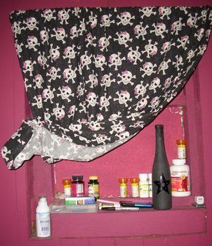 A Stylish Way to Hide a Cubby Hole .  Free tutorial with pictures on how to make a curtain/blinds in under 180 minutes by decorating, embellishing, sewing, and paper folding with fabric, scissors, and thread. Inspired by gothic, monsters, and skulls & skeletons. How To posted by Queen of the Sidhe. Difficulty: Simple. Cost: Cheap. Steps: 4