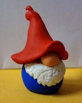 Little tomte guy :) .  Sculpt a clay gnome in under 30 minutes by molding with oven and fimo. Inspired by gnomes. Creation posted by EVEnl. Difficulty: Simple. Cost: Absolutley free.