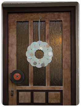 Great for any office door and for all music lovers! .  Free tutorial with pictures on how to make a recycled wreath in under 50 minutes by spraypainting, embellishing, collage, and not sewing with glue, embellishments, and spray paint. Inspired by christmas. How To posted by Anke A. Difficulty: Simple. Cost: Cheap. Steps: 10