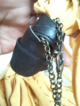 Xmas is coming, and so are the home made gift ideas! .  Make a t-shirt scarf in under 40 minutes by not sewing with t shirt, leather, and necklace. Inspired by clothes & accessories. Creation posted by EJ W. Difficulty: Easy. Cost: Cheap.
