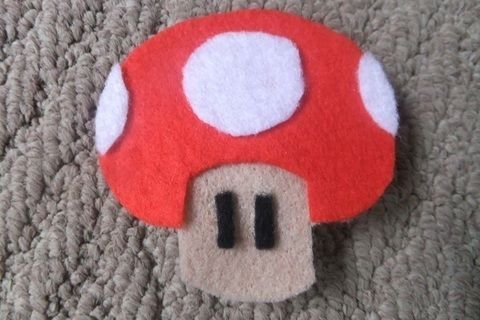 For the gamers out there. .  Sew a fabric character brooch in under 20 minutes by jewelrymaking and sewing with felt, glue, and brooch back. Inspired by mushrooms & toadstools. Creation posted by JossieAyame. Difficulty: Easy. Cost: Absolutley free.