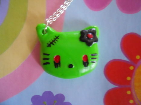 Cute zomnie kitty .  Sculpt a clay animal necklace in under 60 minutes by jewelrymaking and molding with acrylic paint, polymer clay, and polymer clay glaze. Creation posted by Black Sunshine. Difficulty: Simple. Cost: 3/5.