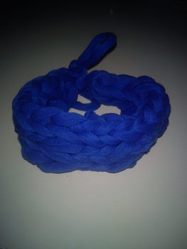 A jersey bracelet made using fingerweaving. Very cute! .  Make a braided fabric bracelet in under 15 minutes by weaving and not sewing with t shirt. Inspired by clothes & accessories. Creation posted by Ira D. Difficulty: Easy. Cost: No cost.