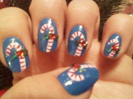 Cute candy cane nail art to help get you in the christmas spirit .  Paint seasonal nail art in under 15 minutes by creating and nail painting with nail polish, rhinestones, and nail. Inspired by christmas. Creation posted by Nail Art and other DIY. Difficulty: Easy. Cost: Cheap.