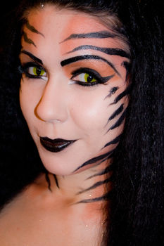 Fantasy makeup to bring out the animal in you ;) .  Create a face painting in under 120 minutes by applying makeup and applying makeup with paint. Inspired by cats, creatures, and gothic. Creation posted by Zombie Ate My Make Up. Difficulty: 4/5. Cost: No cost.