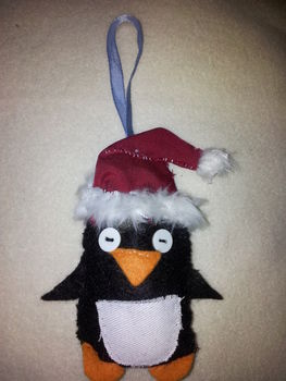 Scruffy little tree ornament .  Make a Christmas decoration in under 180 minutes by embellishing and sewing with fabric, felt, and felt. Inspired by christmas, penguins, and santa claus. Creation posted by Hayley S. Difficulty: Simple. Cost: Absolutley free.