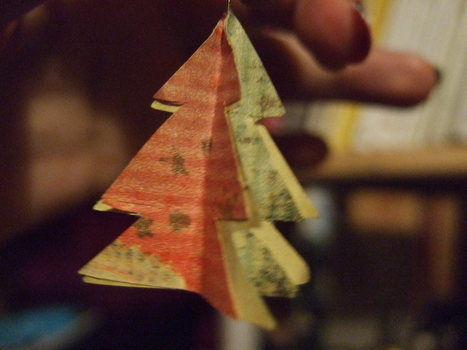 Cool Christmas origamis turn into earrings! .  Free tutorial with pictures on how to make a set of paper earrings in under 30 minutes by papercrafting, collage, decoupaging, and paper folding with paper and glue. Inspired by christmas. How To posted by Delluattack. Difficulty: Simple. Cost: No cost. Steps: 5