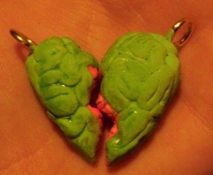 Give your best friend a piece of YOUR zombie heart! .  Sculpt a clay heart charm in under 60 minutes by creating, drawing, spraypainting, constructing, decorating, embellishing, jewelrymaking, metalworking, molding, wireworking, and paper folding with paint, acrylic paint, and paint brush. Inspired by halloween, zombies, and gothic. Creation posted by Bloo Rayne. Difficulty: Easy. Cost: Absolutley free.