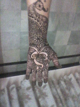 Mehendi in my hands .  Paint a henna tattoo in under 60 minutes by applying makeup with mehendi, cone. Creation posted by Vandana J. Difficulty: Easy. Cost: Cheap.
