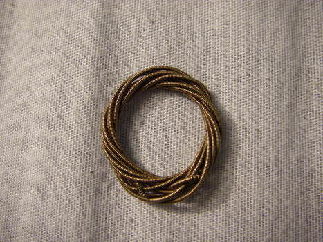 Turn old, used guitar strings into fashion accessories.. .  Make a recycled ring in under 10 minutes by wireworking and jewelrymaking with needle and guitar string. Inspired by clothes & accessories. Creation posted by Jessie D. Difficulty: Simple. Cost: No cost.