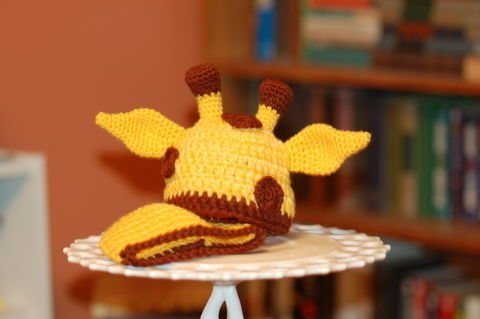 More elusive than any giraffe in the wild.. .  Make an animal hat by photographing, sewing, crocheting, and dressmaking with yarn, crochet hook, and yarn needle. Inspired by creatures, giraffe, and people. Creation posted by K.B. R. Difficulty: Easy. Cost: 3/5.
