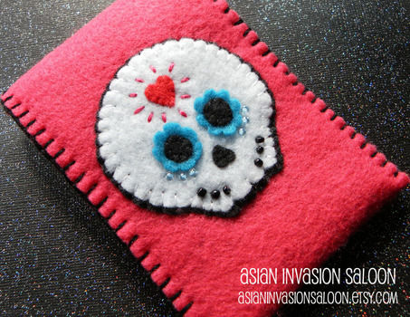 A cute kawaii protective case for your phone or ipod :) .  Stitch an applique pouch in under 120 minutes by embroidering and sewing with felt. Inspired by kawaii. Creation posted by lotusbomb. Difficulty: Simple. Cost: Absolutley free.