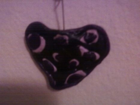A leopard spotted necklace .  Sculpt a clay shape necklace in under 60 minutes by creating, jewelrymaking, molding, and  with polymer clay, chain, and lobster clasp. Inspired by hearts, hearts, and leopard. Creation posted by kittybadass5 c. Difficulty: 3/5. Cost: 3/5.