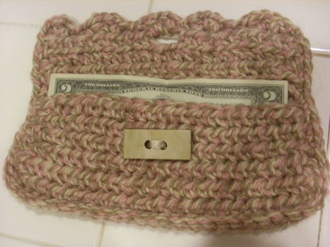 Adorable Wallet w/ Button .  Stitch a knit or crochet pouch in under 60 minutes by crocheting with yarn and buttons. Inspired by for grandmothers. Creation posted by Jill T. Difficulty: Easy. Cost: Cheap.