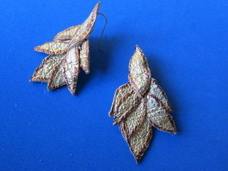 Sew some golden leather leaf earrings. .  Free tutorial with pictures on how to make a pair of leather earrings in under 40 minutes by jewelrymaking with scissors, needle, and marker pen. How To posted by Sonya N. Difficulty: Simple. Cost: Cheap. Steps: 9