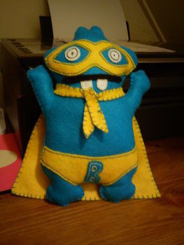 A mini super hero to be your sidekick! .  Make a food plushie in under 90 minutes by needleworking with scissors, felt, and paper. Inspired by domo kun, domo kun, and monsters. Creation posted by Lisa C. Difficulty: Easy. Cost: Cheap.
