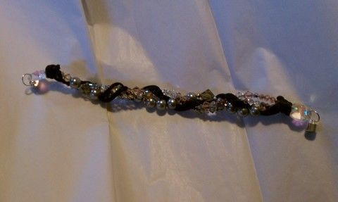 Girly glitz .  Bead a crystal bracelet in under 90 minutes by beading, braiding, and jewelrymaking with crystal beads. Inspired by swarovski. Creation posted by Sarah T. Difficulty: Simple. Cost: 4/5.