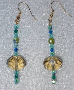 Earrings made of different shades of blue pearls .  Make a pair of beaded earrings in under 20 minutes by beading with glass pearl beads. Inspired by clothes & accessories. Creation posted by campaspe. Difficulty: Easy. Cost: Absolutley free.