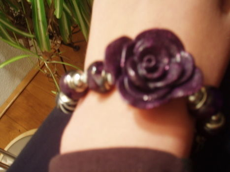 Little fimo rose bracelet, Black, white and purple .  Make a bracelet in under 20 minutes by creating, beading, decorating, jewelrymaking, potting, knitting, and engraving with beads and polymer clay. Inspired by christmas, creatures, and gothic. Creation posted by Sigrid. Difficulty: Simple. Cost: Absolutley free.
