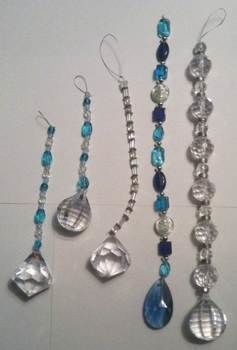 Inspired from Pyramid Collection Catalog .  Make a sun catcher in under 120 minutes by beading, jewelrymaking, and wireworking with scissors, wire, and glass beads. Inspired by costumes & cosplay and vintage & retro. Creation posted by Queen of the Sidhe. Difficulty: Easy. Cost: 3/5.