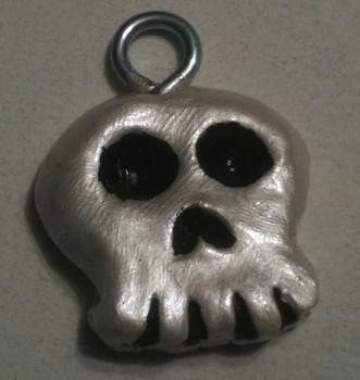 A charming little skull for you.. .  Make a skull pendant in under 30 minutes by jewelrymaking, molding, and decorating with acrylic paint, paint brush, and oven. Inspired by gothic, costumes & cosplay, and vintage & retro. Creation posted by Queen of the Sidhe. Difficulty: Easy. Cost: Absolutley free.