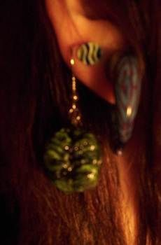 Brains... green gooey brains... .  Sculpt a set of clay character earrings in under 60 minutes by jewelrymaking, molding, wireworking, and decorating with acrylic paint, paint brush, and earring hooks. Inspired by halloween, zombies, and gothic. Creation posted by Bloo Rayne. Difficulty: Easy. Cost: Absolutley free.