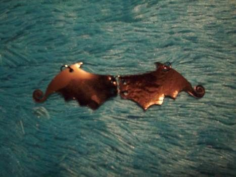 Going a little batty, lately? .  Make a pendant necklace in under 20 minutes by jewelrymaking, melting, and jewelrymaking with scissors, jump rings, and oven. Inspired by halloween, creatures, and gothic. Creation posted by Bloo Rayne. Difficulty: Easy. Cost: Absolutley free.