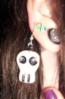 Punisher Skull Earrings .  Sculpt a set of clay character earrings in under 30 minutes by jewelrymaking, molding, and decorating with acrylic paint, paint brush, and earring hooks. Inspired by halloween, gothic, and costumes & cosplay. Creation posted by Bloo Rayne. Difficulty: Easy. Cost: Absolutley free.