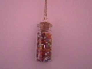 A cute tiny jar with small beads. .  Free tutorial with pictures on how to make a vial in under 20 minutes using scissors, beads, and glue. Inspired by clothes & accessories. How To posted by xYaelle. Difficulty: Easy. Cost: Cheap. Steps: 4
