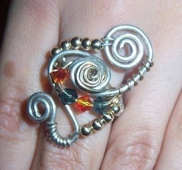 Silver and 14kt gold filled ring with bead and crystals .  Make a wire ring by jewelrymaking with silver wire. Creation posted by Nancy C. Difficulty: 3/5. Cost: 4/5.