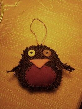 A little scruffy robin to hang on the tree :)  .  Make a Christmas decoration in under 45 minutes by sewing with fabric, thread, and thread. Inspired by christmas, birds, and robin. Creation posted by Hayley S. Difficulty: Easy. Cost: Absolutley free.