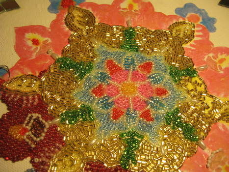 Inspired by indian culture of making rangoli for festivals .  Bead a model by beading with seed beads, patience, and pva glue. Creation posted by Ramacreates. Difficulty: Simple. Cost: 3/5.