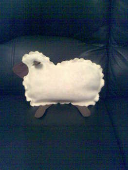 A little lamb pillow .  Make a lamb / sheep plushie in under 180 minutes by sewing with fabric and felt. Inspired by sheep. Creation posted by Rellijac J. Difficulty: Easy. Cost: 3/5.