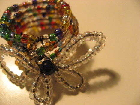 Beaded ring of wrapped wire .  Make a ring in under 30 minutes by beading and wireworking with beads and beading wire. Inspired by flowers, flowers, and flowers. Creation posted by emmableu b. Difficulty: Easy. Cost: Absolutley free.