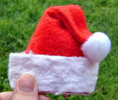 Add a little holiday cheer with this fast, easy, and inexpensive mini hat. .  Free tutorial with pictures on how to make a novelty hat in under 45 minutes by decorating, not sewing, paper folding, and sewing with materials. Inspired by christmas, costumes & cosplay, and santa claus. How To posted by Vermin Jerky. Difficulty: Easy. Cost: Absolutley free. Steps: 18