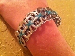 :) .  Make a pop tab bracelet in under 10 minutes by not sewing with embroidery thread and can tabs. Inspired by clothes & accessories. Creation posted by momoevergreen. Difficulty: Easy. Cost: No cost.